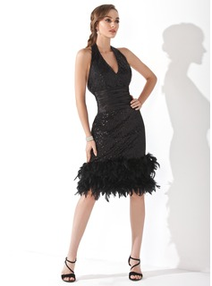 Sheath/Column Halter Knee-Length Sequined Cocktail Dress With Ruffle Feather