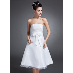 A-Line/Princess Strapless Knee-Length Organza Homecoming Dress With Ruffle Bow(s)