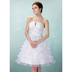 A-Line/Princess V-neck Knee-Length Organza Homecoming Dress With Beading Cascading Ruffles
