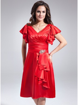 A-Line/Princess V-neck Knee-Length Charmeuse Mother of the Bride Dress With Crystal Brooch Cascading Ruffles