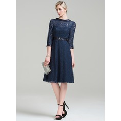 A-Line/Princess Scoop Neck Knee-Length Lace Cocktail Dress With Ruffle Beading Sequins